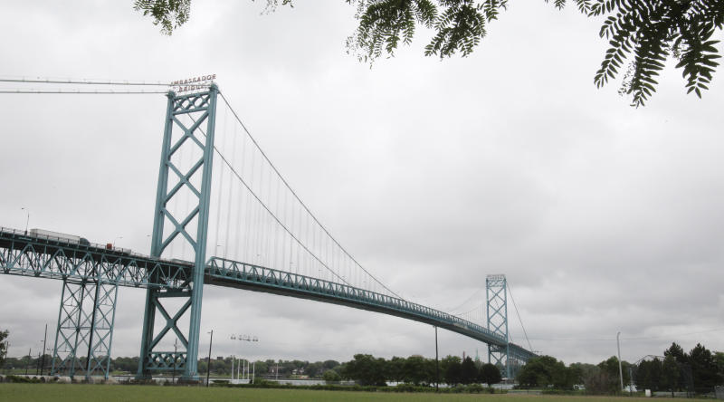 FILE - In a June 24, 2011 file photo, the Ambassador Bridge, spanning the Detroit River and linking the U.S. and Canada, is seen from Detroit. Officials have reached an agreement to build a new Canadian-financed bridge linking Detroit and Windsor, Ontario, a massive construction project that could create thousands of jobs and increase international trade, the Michigan governor's office announced Friday, June 15, 2012. (AP Photo/Carlos Osorio, File)