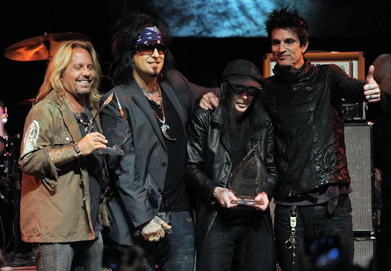 FILE - In this Aug. 18, 2011 file photo, from left, Vince Neil, Nikki Sixx, Mick Mars and Tommy Lee of the band Motley Crue pose together onstage at a tribute to the band to launch the 4th Annual Sunset Strip Music Festival in West Hollywood, Calif. The heavy-metal band says it will retire after performing 72 goodbye concerts. The band made the announcement at a press conference Tuesday, Jan. 28, 2014, in Hollywood. (AP Photo/Chris Pizzello, File)