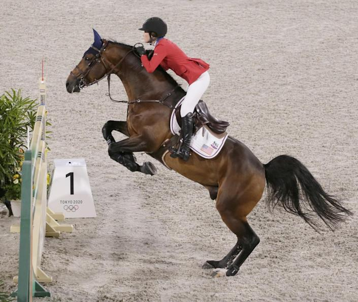 Jessica Springsteen's horse prepares to leap an obstacle.