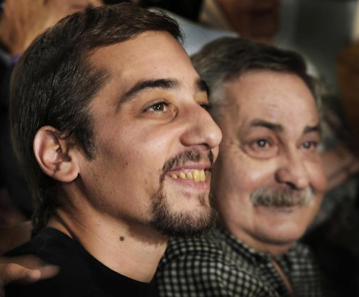 Francisco Madariaga Quintela (L) smiles next to his father Abel Madariaga during a press conference in Buenos Aires on February 23, 2010 (AFP Photo/Daniel Garcia)
