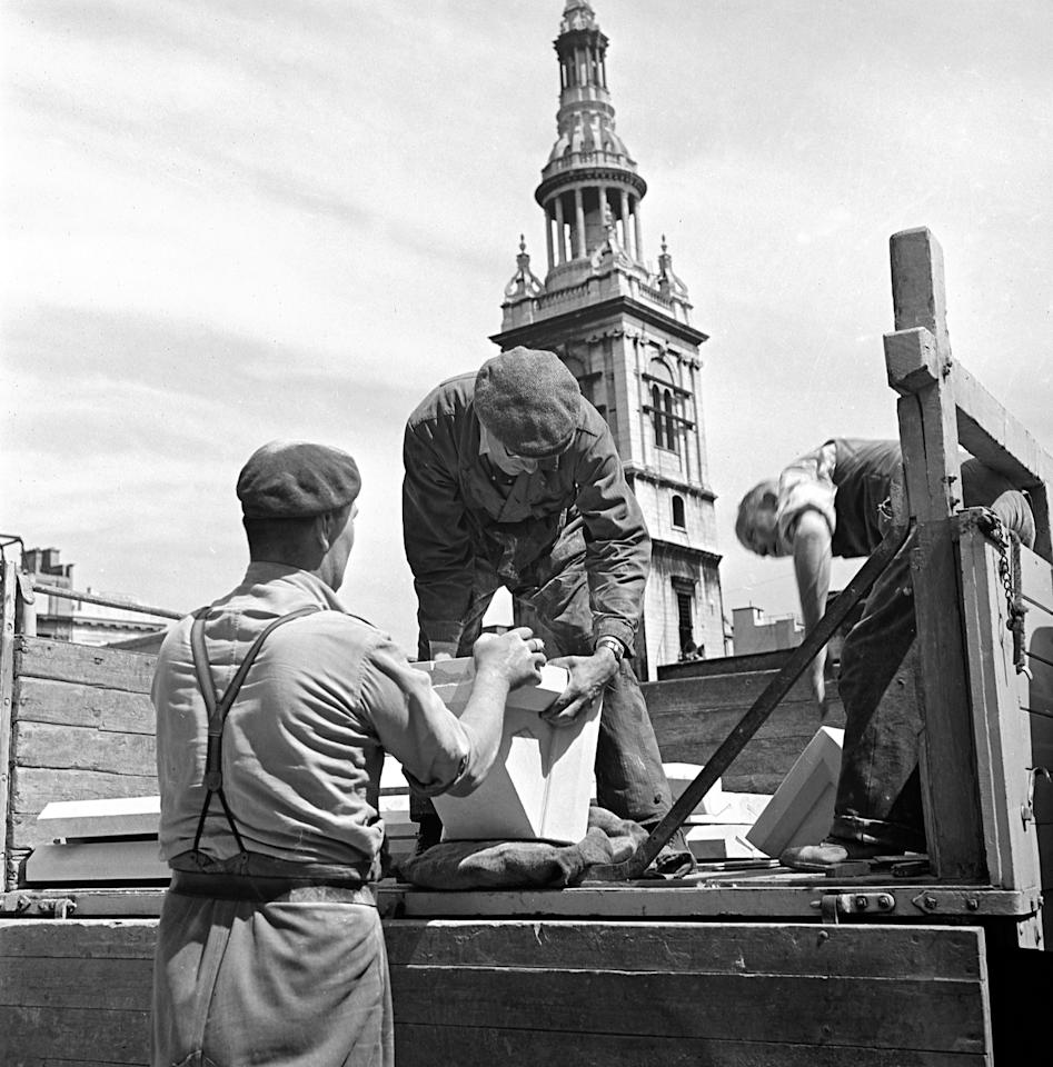 <p>Workmen carry out repairs in 1950s London as Britain began to rebuild after the Blitz. Mediadrumimages/TopFoto </p>