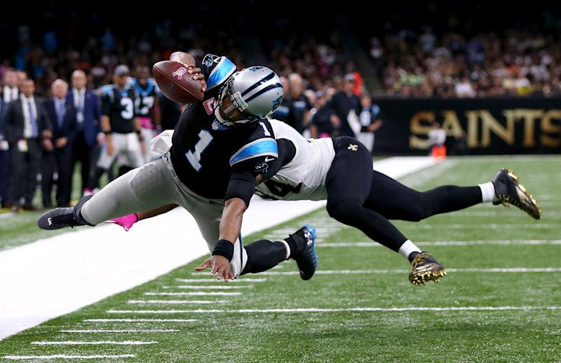 Cam Newton stretches for a touchdown against New Orleans (Getty Images)
