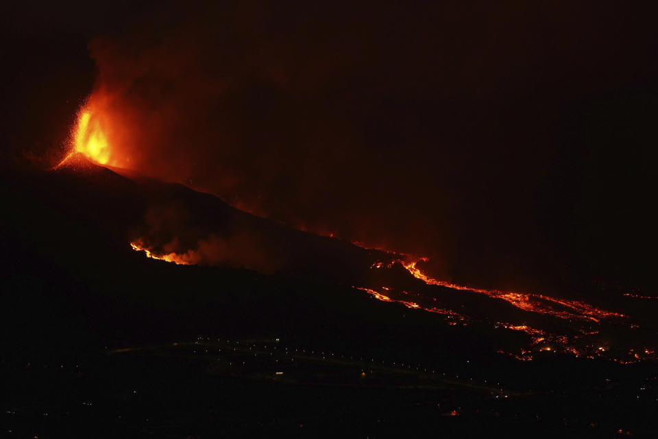 Lava erupts from a volcano near El Paso on the island of La Palma in the Canaries, Spain, Monday Sept. 20, 2021. Giant rivers of lava are tumbling slowly but relentlessly toward the sea after a volcano erupted on a Spanish island off northwest Africa. The lava is destroying everything in its path but prompt evacuations helped avoid casualties after Sunday's eruption. (Europa Press via AP) *
