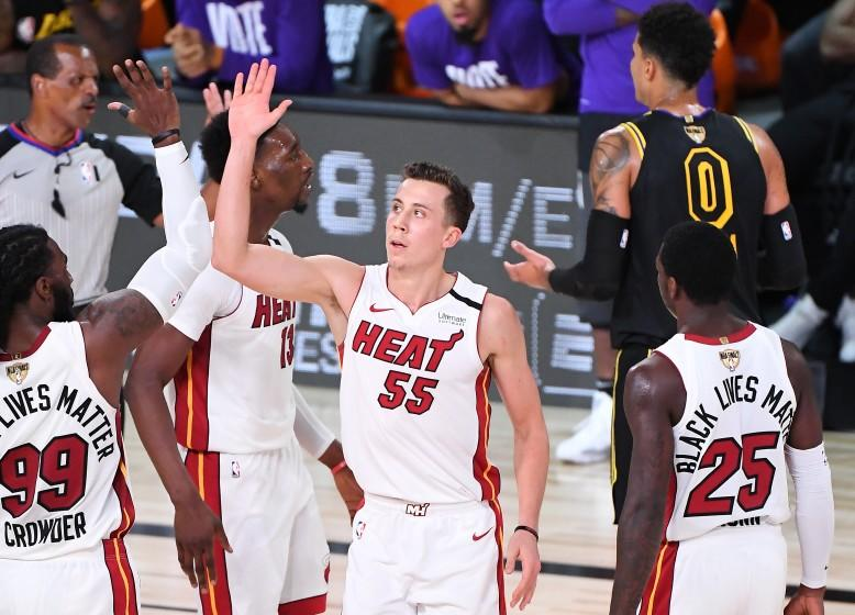 ORLANDO, FLORIDA OCTOBER 9, 2020-Heat's Duncan Robinson celebrates with Jae Crowder after his three-point basket and being fouled by Lakers Kyle Kuzma in Game 5 of the NBA FInals in Orlando Friday. (Wally Skalij/Los Angeles Times)