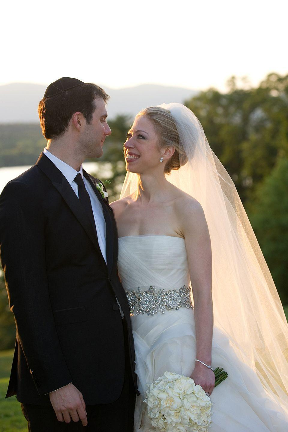 <p>Chelsea Clinton tied the knot with Marc Mezvinsky in a strapless Vera Wang gown fit for an American princess. The silver hand-embroidered crystal sash complimented the generous layers of ruffled silk organza. She wore a head-turning cathedral-length veil to walk down the aisle.</p>