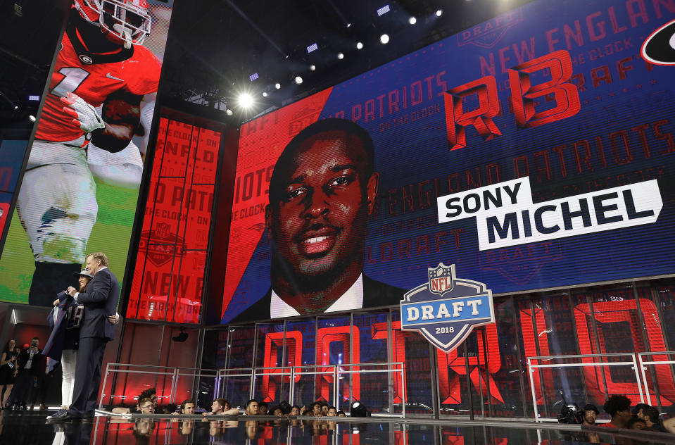 Commissioner Roger Goodell poses with a fan after the New England Patriots selected Georgia's Sony Michel. (AP)