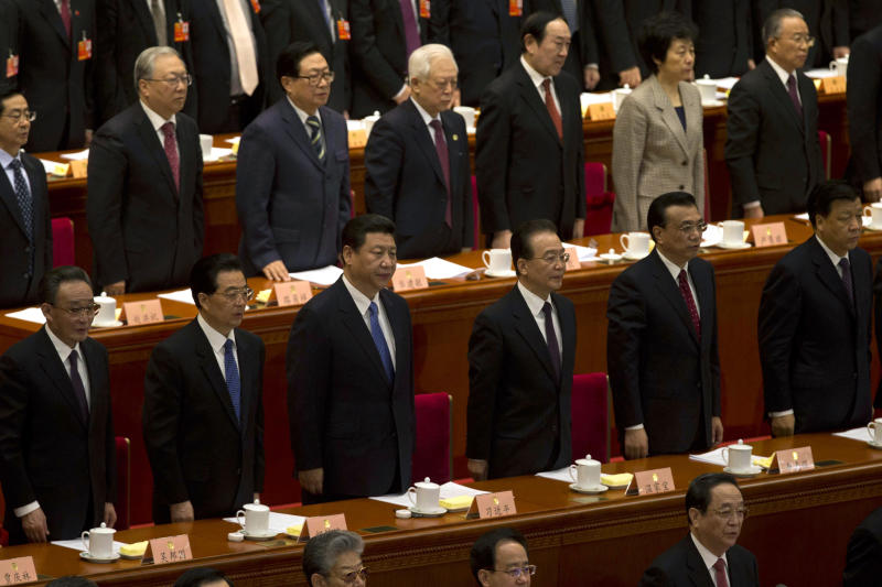 China's top leaders from left, outgoing-Chairman of the National People's Congress, Wu Bangguo, Chinese President Hu Jintao, Chinese Communist Party chief and incoming-President Xi Jinping, Chinese Premier Wen Jiabao and incoming-Premier Li Keqiang stand for the national anthem during the closing session of the annual Chinese People's Political Consultative Conference held inside Beijing's Great Hall of the People, in China, Tuesday, March 12, 2013. (AP Photo/Ng Han Guan)