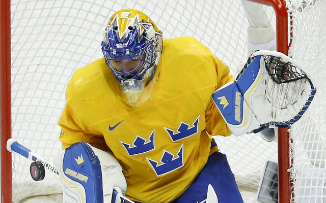 Sweden goaltender Henrik Lundqvist blocks a shot by Slovenia in the second period of a men's ice hockey game at the 2014 Winter Olympics, Wednesday, Feb. 19, 2014, in Sochi, Russia. (AP Photo/Mark Humphrey)