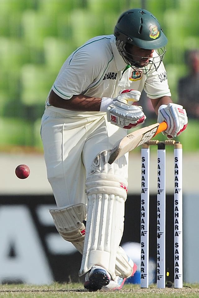 Bangladesh cricketer Mohammad Mahmudullah is hit by a bouncer by West Indies cricketer Tino Best during the fifth day of the first cricket Test match between Bangladesh and The West Indies at the Sher-e-Bangla National Cricket Stadium in Dhaka on November 17, 2012.  AFP PHOTO/ Munir uz ZAMAN
