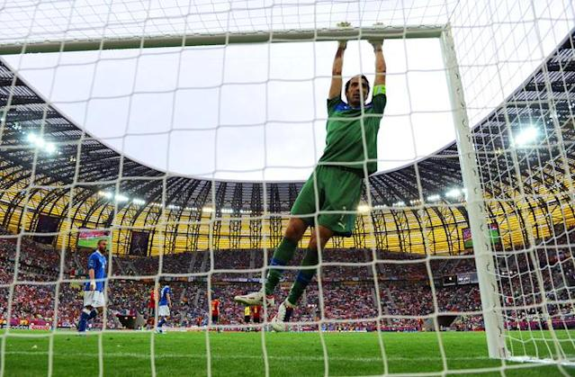 GDANSK, POLAND - JUNE 10: Gianluigi Buffon of Italy hangs off the cross bar during the UEFA EURO 2012 group C match between Spain and Italy at The Municipal Stadium on June 10, 2012 in Gdansk, Poland. (Photo by Jasper Juinen/Getty Images)