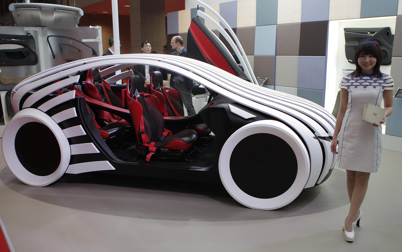 Toyota Boshoku Corp.'s concept vehicle T-Brain is displayed during the press preview of Tokyo Motor Show in Tokyo, Wednesday, Nov. 30, 2011. The Tokyo Motor Show opens to the public this weekend. (AP Photo/Itsuo Inouye)
