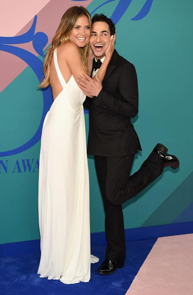 <p>The model and her date kick back. (Photo: Getty Images) </p>