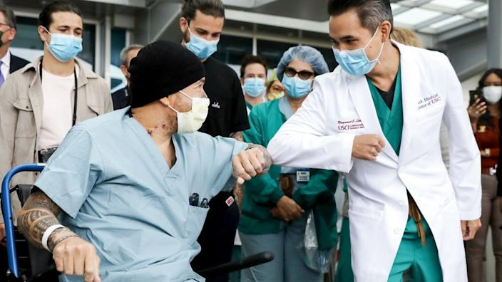 A recovering Covid patient in LA receives an elbow bump from a doctor
