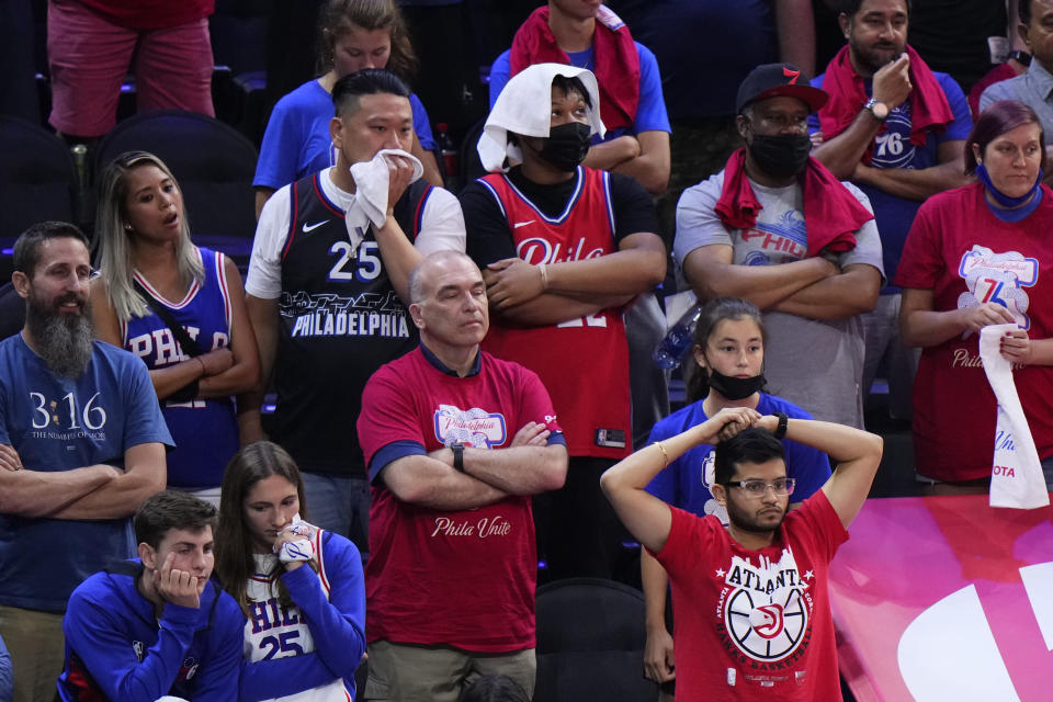 Philadelphia 76ers' fan react in the final seconds of Game 7 in a second-round NBA basketball playoff series against the Atlanta Hawks, Sunday, June 20, 2021, in Philadelphia. (AP Photo/Matt Slocum)