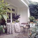 """<p>Lee had the 18th century manor <a href=""""https://scenetherapy.com/lee-radziwills-english-house-turville-grange/"""" rel=""""nofollow noopener"""" target=""""_blank"""" data-ylk=""""slk:decorated by famed Italian designer"""" class=""""link rapid-noclick-resp"""">decorated by famed Italian designer</a>, Lorenzo Mongiardino, who incorporated floral hand-painted wallpaper, exotic prints and many house plants. Here's a glimpse of the home's well-manicured patio. </p>"""
