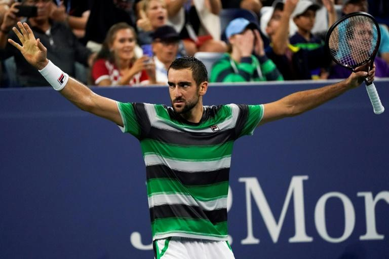 Instant classic: Marin Cilic celebrates after his five-set, four-hour US Open victory over Alex de Minaur on Louis Armstrong Stadium