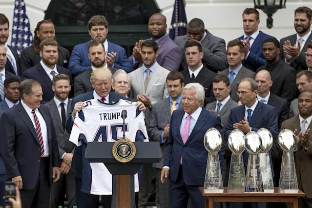 <p>President Donald Trump is presented with a New England Patriots jersey by Patriots head coach Bill Belichick, left, and New England Patriots owner Robert Kraft, center, during a ceremony on the South Lawn of the White House in Washington, Wednesday, April 19, 2017, where the president honored the Super Bowl Champion New England Patriots for their Super Bowl LI victory. Also pictured is New England Patriots president Jonathan Kraft, second from right. (AP Photo/Andrew Harnik) </p>