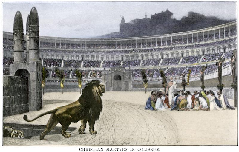 Christian martyrs facing hungry lions in the Colosseum in ancient Rome. (Photo: North Wind Picture Archives / Alamy Stock Photo)