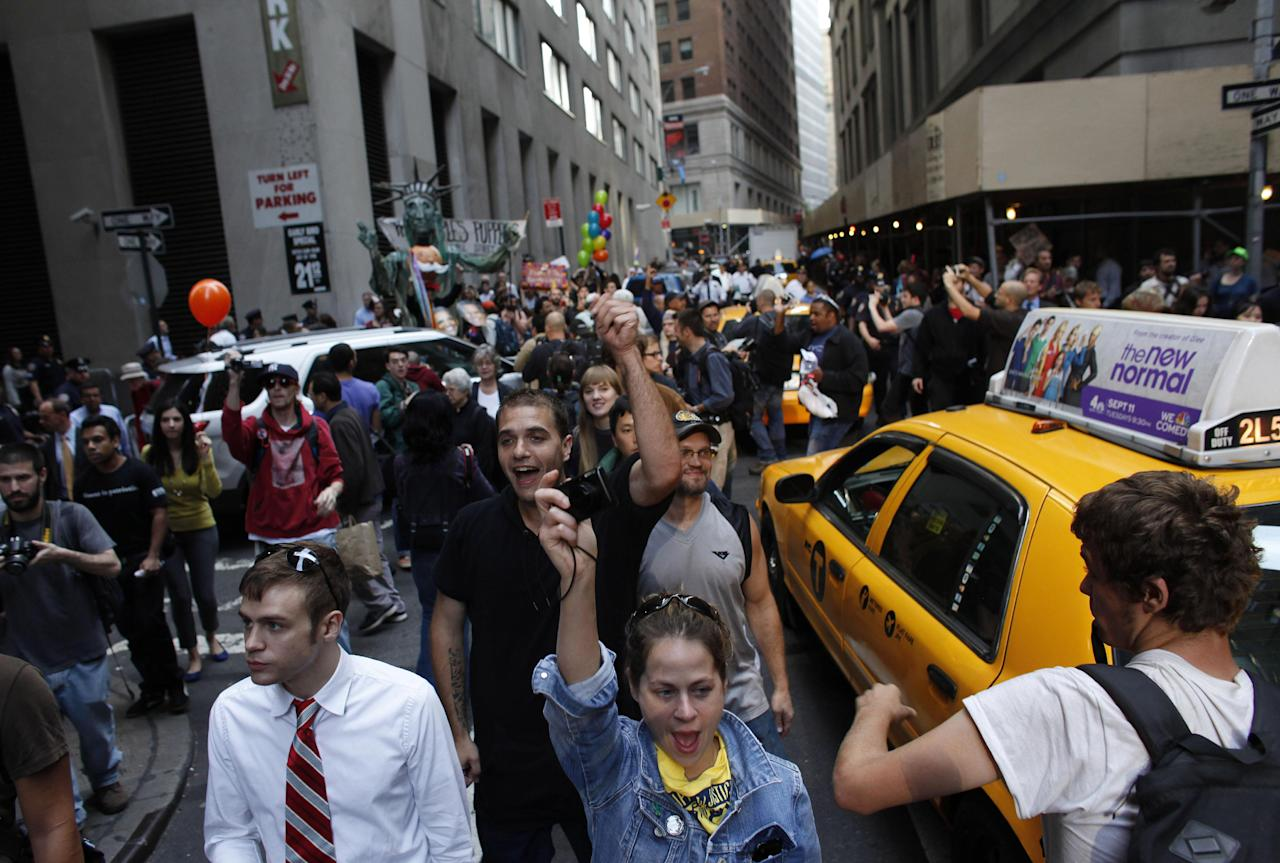 Protestors fill an intersection during an Occupy Wall Street march, Monday, Sept. 17, 2012, in New York. A handful of Occupy Wall Street protestors were arrested during a march on the New York Stock Exchange on the anniversary of the grass-roots movement. (AP Photo/Jason DeCrow)