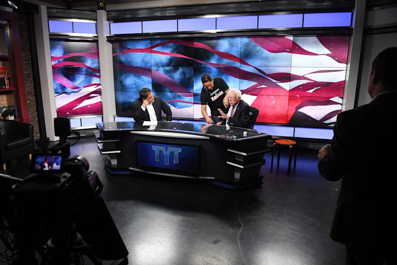 Sen. Bernie Sanders prepares for an interview with Cenk Uygur, left, at the Young Turks studios in Culver City, California, during his 2016 presidential run. Uygur had long been a key ally. (Photo: Matt McClain/The Washington Post via Getty Images)