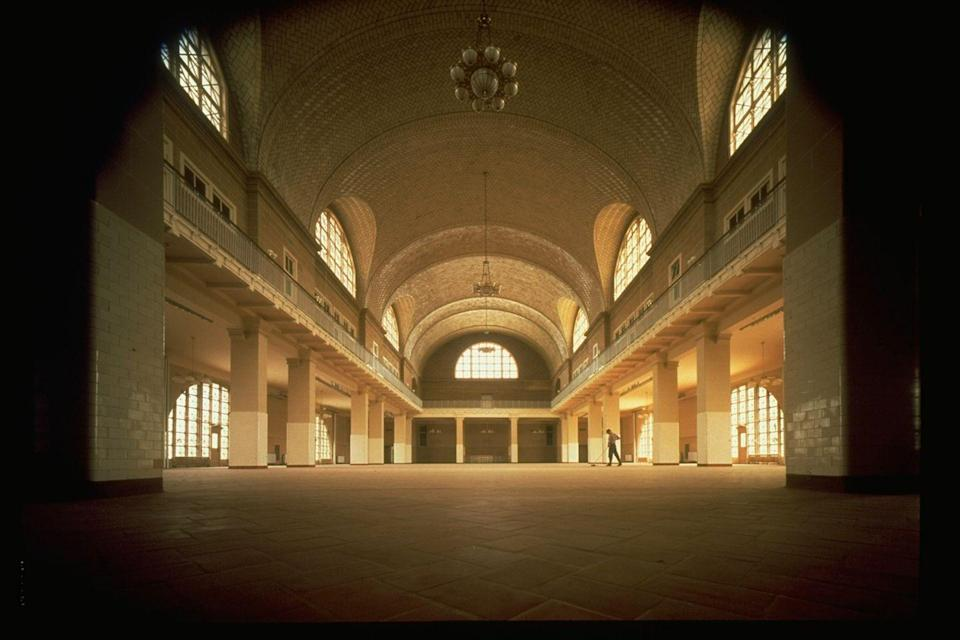 """<p><a href=""""https://www.tripadvisor.com/Attraction_Review-g60763-d104370-Reviews-Ellis_Island-New_York_City_New_York.html"""" rel=""""nofollow noopener"""" target=""""_blank"""" data-ylk=""""slk:Ellis Island's"""" class=""""link rapid-noclick-resp"""">Ellis Island's</a> registry room was restored and opened in 1990 as a National Park Service museum commemorating four centuries of US immigration. </p>"""