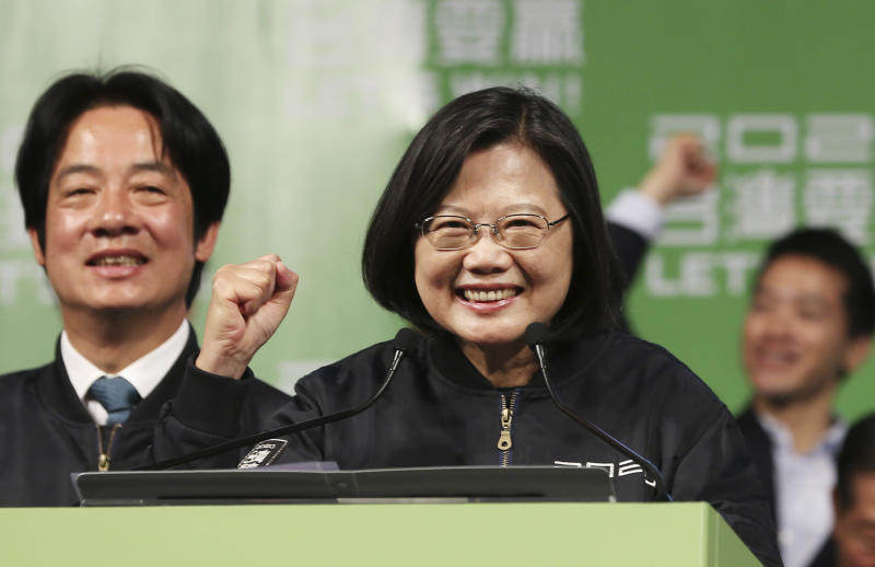 Taiwan's 2020 presidential election candidate, Taiwanese President Tsai Ing-wen celebrates her victory with supporters in Taipei, Taiwan, Saturday, Jan. 11, 2020. Taiwan's independence-leaning President Tsai Ing-wen won a second term in a landslide election victory Saturday, signaling strong support for her tough stance against China. (AP Photo/Chiang Ying-ying)