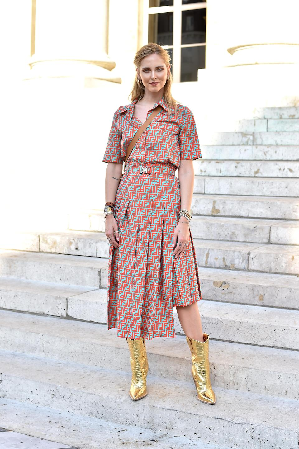 <p>Chiara Ferragni sat FROW at the Fendi haute couture show on 4 July in a logo-emblazoned dress and gold boots.<em> [Photo: Getty]</em> </p>