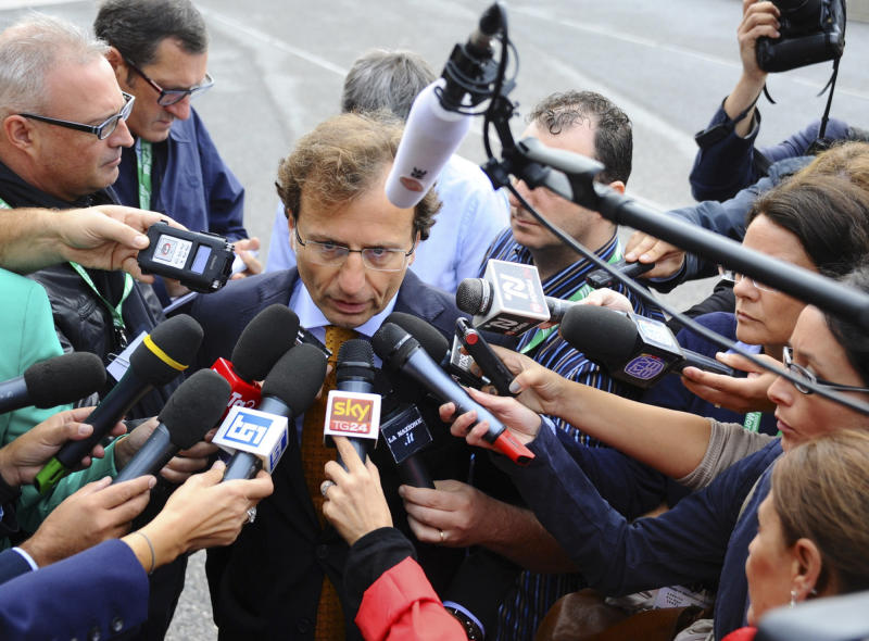 "Kercher family lawyer Francesco Maresca talks to reporters as he arrives for the start of U.S. student Amanda Knox's second appeals trial in her British roommate's murder, in Florence, Italy, Monday, Sept. 30, 2013. Italy's highest court ordered a new trial for Knox and her former Italian boyfriend, overturning their acquittals in the gruesome 2007 slaying of Meredith Kercher with a harsh assessment of an appeals court acquittal in 2011. The Court of Cassation said the acquittal was full of ""deficiencies, contradictions and illogical"" conclusions. (AP Photo/Francesco Bellini)"