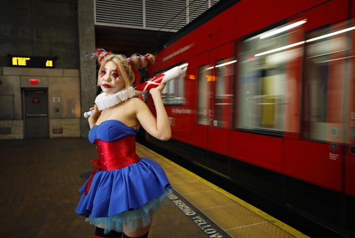 Tita Ghanjanasak dressed as Harley Quinn Batman: The Dark Prince Charming at the San Diego State University Transit Station. Ghanjanasak has been going to Comic-Con for four years and her favorite thing see is the Game of Thrones cosplay.