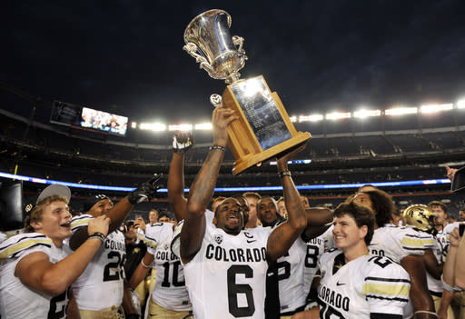 Colorado Buffaloes wide receiver Paul Richardson (6) riases the Rocky Mountain Showdown Cup as they celebrate their 41-27 victory over Colorado State during an NCAA college football game, Sunday, Sept. 1, 2013, in Denver. (AP Photo/Jack Dempsey)