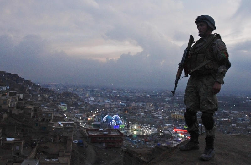 An Afghan Army soldier secures the hill overlooking the Kart-e Sakhi mosque in Kabul, Afghanistan, Wednesday, March 20, 2013. Thousands of Afghans will celebrate on Thursday, March 21, 2013, the Iranian New Year Nowruz, marking the first day of spring and the beginning of the year on the Iranian calendar. (AP Photo/Ahmad Jamshid)