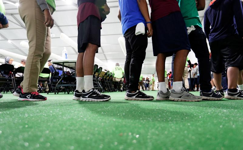 Migrants line up in the dining hall at the U.S. government's newest holding center for migrant children in Carrizo Springs, Texas, on July 9. (Photo: POOL New / Reuters)