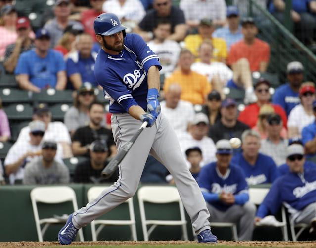 Los Angeles Dodgers' Scott Van Slyke hits a grand slam during the sixth inning of an exhibition spring training baseball game against the Los Angeles Angels Thursday, March 6, 2014, in Tempe, Ariz. (AP Photo/Morry Gash)
