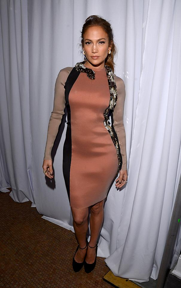 """And last but not least we have Jennifer Lopez, who showcased her signature curves in a polarizing Lanvin dress backstage at a press conference where she announced her <a target=""""_blank"""" href=""""http://omg.yahoo.com/news/jennifer-lopez-enrique-iglesias-embark-13-city-tour-191500836.html"""">upcoming concert tour with Enrique Iglesias</a>. Are you fond of J.Lo's tri-colored, snake-adorned dress and Giuseppe Zanotti ankle-strap pumps? Hot or not? (4/30/2012)<br><br><a target=""""_blank"""" href=""""http://bit.ly/lifeontheMlist"""">Follow 2 Hot 2 Handle creator, Matt Whitfield, on Twitter!</a>"""