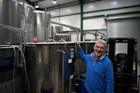 """""""It's not a wine to be taken too seriously, it's a fun drink, says Simon Day, posing at his vineyard in Ledbury, where the UK's first red primeur is being made"""