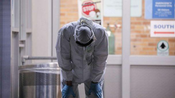 PHOTO: A medical worker stretches outside Maimonides Medical Center during the outbreak of the coronavirus disease in the Brooklyn borough of New York, April 14, 2020. (Caitlin Ochs/Reuters)