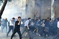 Police fired tear gas at office workers who gathered in central Hong Kong during lunch hour