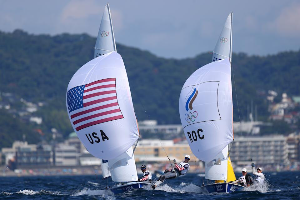 <p>FUJISAWA, JAPAN - AUGUST 01: Stuart McNay and David Hughes of Team United States and Pavel Sozykin and Denis Gribanov of Team ROC compete in the Men's 470 class on day nine of the Tokyo 2020 Olympic Games at Enoshima Yacht Harbour on August 01, 2021 in Fujisawa, Kanagawa, Japan. (Photo by Clive Mason/Getty Images)</p>