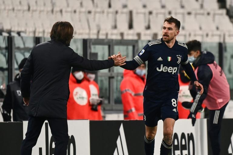 Welsh midfielder Aaron Ramsey (R) celebrates his first goal this season with Juventus coach Andrea Pirlo.