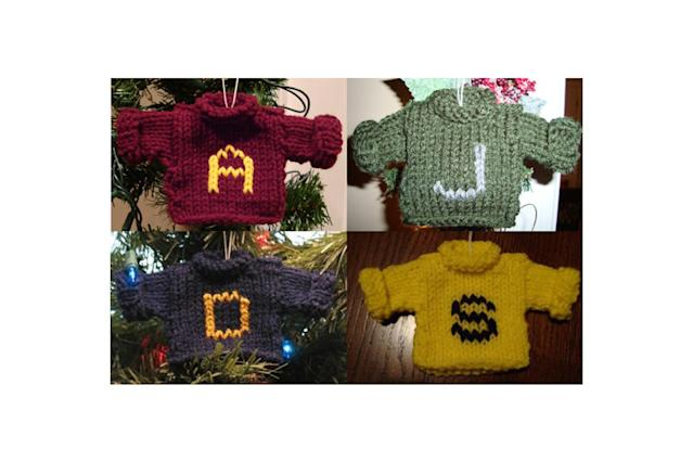 "<p>One of the most precious Christmas gifts the orphaned Harry Potter ever received was the annual sweater made by Mrs. Weasley, which makes this hand-knitted ornament a heartwarming addition to your tree. <a href=""https://www.etsy.com/listing/64102699/harry-potter-weasley-sweater-christmas"" rel=""nofollow noopener"" target=""_blank"" data-ylk=""slk:Buy here"" class=""link rapid-noclick-resp""><strong>Buy here</strong></a> </p>"