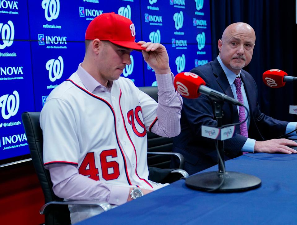 Washington Nationals President of Baseball Operations and General Manager Mike Rizzo, right, announces the signing of pitcher Patrick Corbin, left, during a news conference at Nationals Park in Washington, Friday, Dec. 7, 2018. (AP Photo/Pablo Martinez Monsivais)