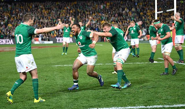 Rugby Union - June Internationals - Australia vs Ireland - Sydney Football Stadium, Sydney, Australia - June 23, 2018 - Johnny Sexton of Ireland celebrates with team mates Bundee Aki and Jordi Murphy after winning the game. AAP/David Moir/via REUTERS ATTENTION EDITORS - THIS IMAGE WAS PROVIDED BY A THIRD PARTY. NO RESALES. NO ARCHIVE. AUSTRALIA OUT. NEW ZEALAND OUT.