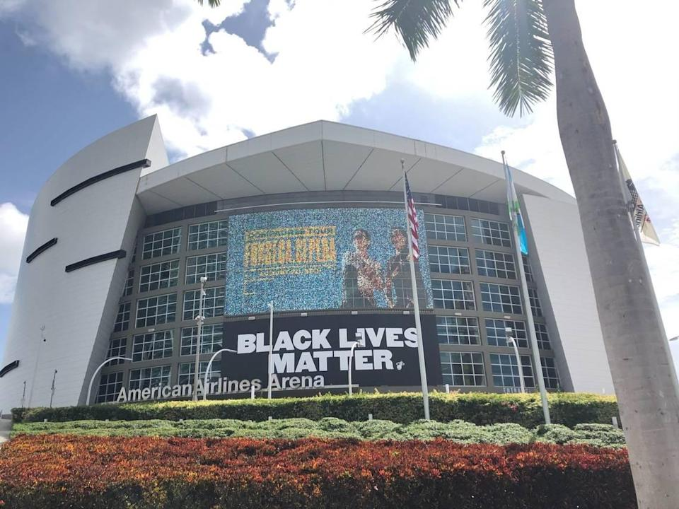 "The ""Black Lives Matter"" banner hanging outside the AmericanAirlines Arena on Sept. 5, 2020, the day after Miami-Dade rejected the Miami Heat's offer to use the arena as an early-voting site. A county deputy mayor later said the decision was based in part on concerns the facility wouldn't be an ""apolitical"" voting site."