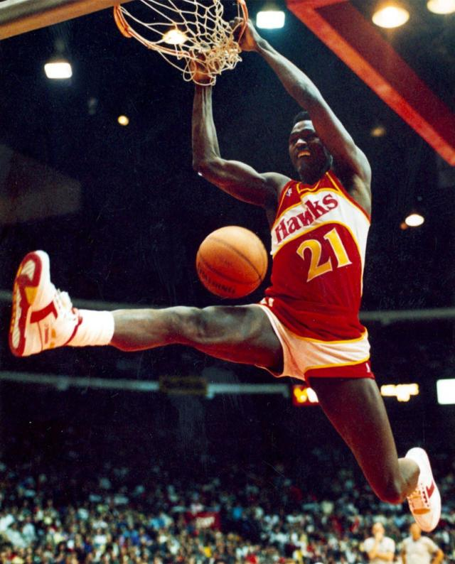 In this Feb. 6, 1988, photo, Atlanta Hawks' Dominique Wilkins follows through on a two-handed dunk during the All-Star Slam Dunk contest in Chicago. Jordan left the old Chicago Stadium that night with the trophy. To this day, many believe Wilkins was the rightful winner. (Charles Cherney/Chicago Tribune via AP)