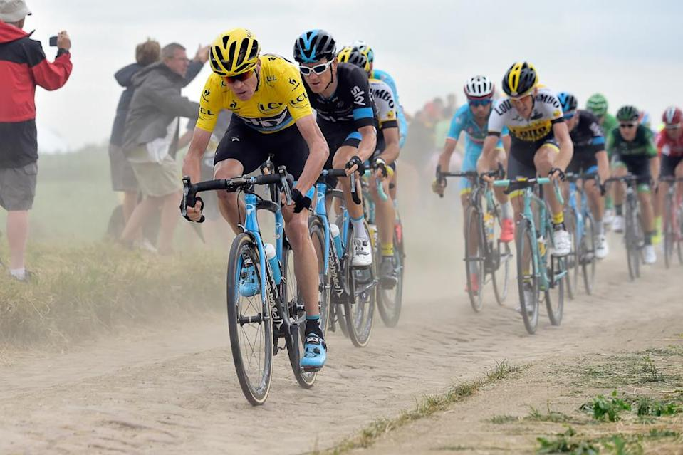 Chris Froome and Geraint Thomas ride the cobbles.