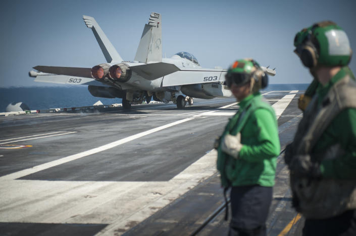 This October 19, 2014 photo provided by the US Navy shows an EA-18G Growler launching from the flight deck of the USS Carl Vinson as the ship conducts flight operations in the US 5th Fleet area of operations supporting Operation Inherent Resolve (AFP Photo/Mc2 Scott Fenaroli)