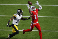 Buffalo Bills wide receiver Stefon Diggs (14) cannot come down with the catch on a pass with Pittsburgh Steelers cornerback Steven Nelson (22) defending during the first half of an NFL football game in Orchard Park, N.Y., Sunday, Dec. 13, 2020. (AP Photo/Jeffrey T. Barnes )