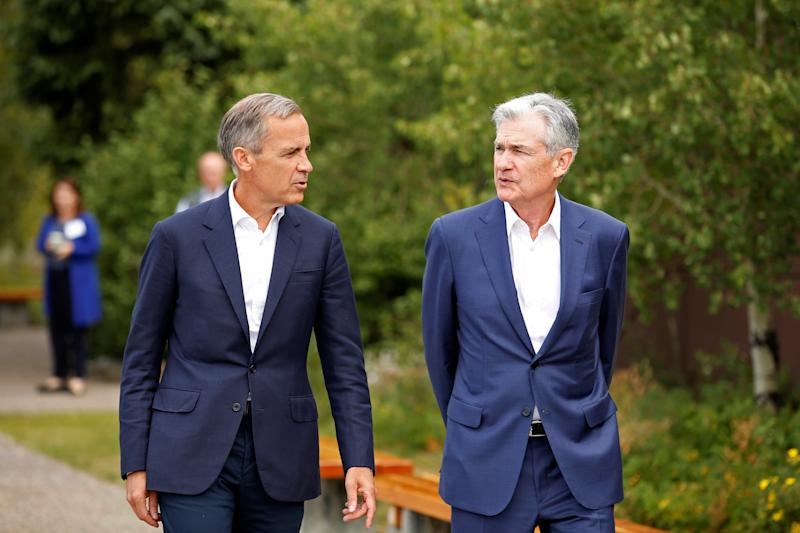 "Federal Reserve Chair Jerome Powell and Governor of the Bank of England, Mark Carney, are seen during the three-day ""Challenges for Monetary Policy"" conference in Jackson Hole, Wyoming, U.S., August 23, 2019. REUTERS/Jonathan Crosby"
