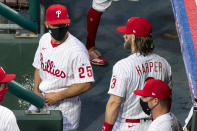 Philadelphia Phillies manager Joe Girardi, left, talks with Bryce Harper, right, prior to a baseball game against the Miami Marlins, Friday, July 24, 2020, in Philadelphia. (AP Photo/Chris Szagola)