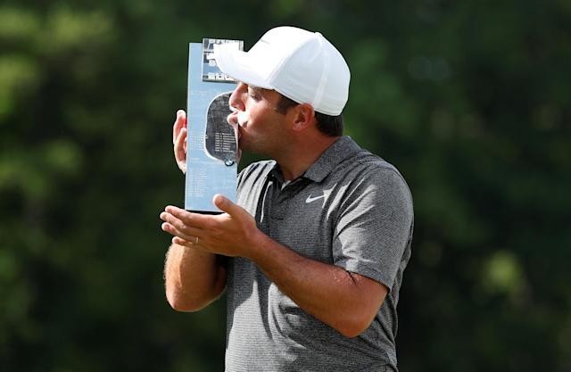 Golf - European Tour - BMW PGA Championship - Wentworth Club, Virginia Water, Britain - May 27, 2018 Italy's Francesco Molinari kisses the trophy as he celebrates after winning the BMW PGA Championship Action Images via Reuters/Peter Cziborra